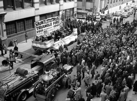 A crowd gathers at the Asch Building for the 50th anniversary of the fire