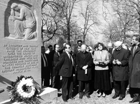 Members of the ILGWU gather around the Longman memorial for unidenitifed victims of the fire