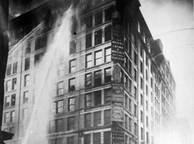 Water from fire hoses spraying the top floors of the Asch Building